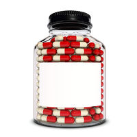Red capsules into the glass bottle