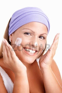 Portrait of attractive woman cleaning face smiling