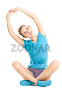 young caucasian woman doing fitness exercises