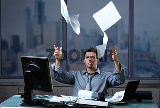 Professional throwing documents into air