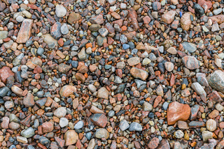 Red Pebble on Ground
