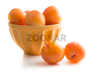Ripe yellow plums in bowl.