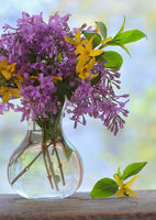 Lilac bouquet on the wooden table