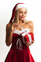 Woman in Santa dress unpack gift