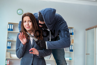 Criminal taking businesswoman as hostage in office