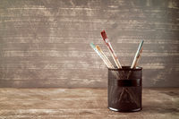 Pot with watercolor brushes