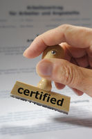certified printed on rubber stamp in hand