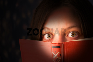 scared girl with a book
