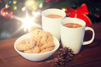 oat cookies and hot chocolate over christmas tree