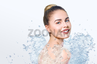 Young beautiful woman with water splash