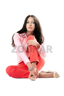 Lovely young woman in red jeans. Isolated on white