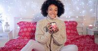 Pretty y woman admiring her Christmas coffee cup
