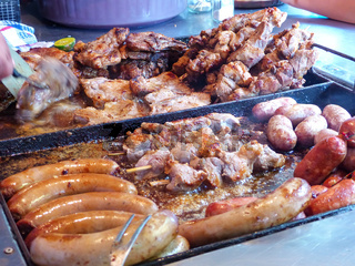 Display of cooked meat for asado at Mercado 4 in Asuncion, Paraguay