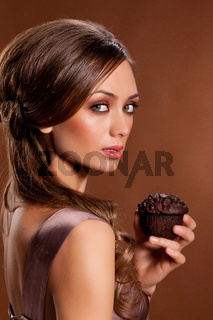 Young Beauriful Woman With Muffin