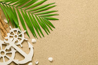 Summer Background with Green Palm Leaf, Decorative Anchor and Ship Steering Wheels