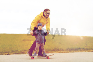happy father and little son on skateboard