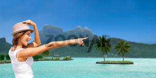 happy young woman in hat on bora bora beach