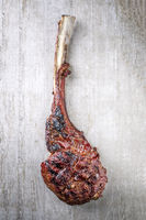Barbecue dry aged Wagyu Tomahawk Steak as close-up on a slab