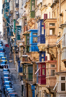 A view of the typical Street of Valletta with traditional maltese balconies.