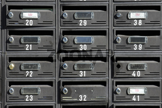 Many letterboxes mailboxes with numbers
