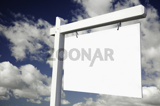 Blank Real Estate Sign on Clouds & Sky Background - Ready for your own message.