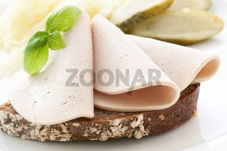 Pork and veal sausage on farmhouse bread as closeup