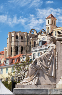 Female allegorical figure with Carmo Convent at the background. Rossio Square. Lisbon, Portugal