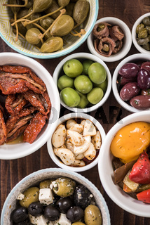 Selection of tapas in ceramic bowls