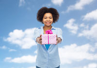 happy african woman with birthday gift box