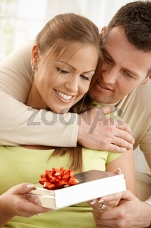 Happy couple with present