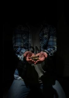 bullet in hands man