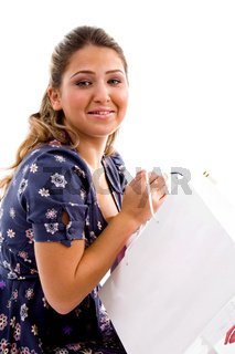 side pose of model holding carry bags