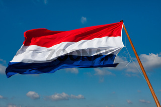 Flag of The Netherlands on pole