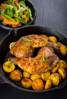 Baked chicken legs with potatos and vegetables