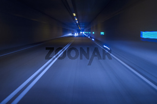 Cars Driving in Tunnel at Night