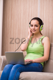 The young girl listening music at home