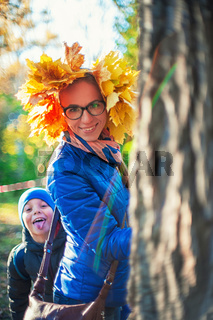 Beauty woman and her son at autumn park