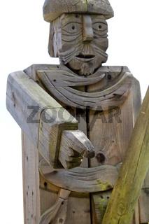 Holzfigur zeigt mit dem Finger