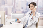 Female doctor talking on phone
