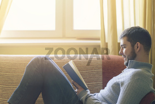 Young man enjoying a great book