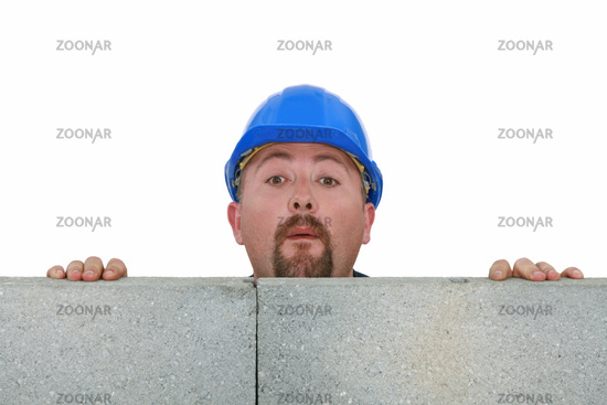 Builder peering over wall
