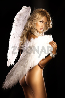 Beautiful naked blonde angel looking at camera.