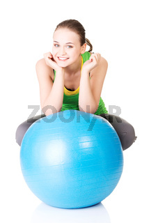 Healthy lifestyle woman with pilates exercise ball.