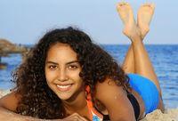 beautiful happy smiling woman relaxing sunbathing on beach