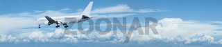 Jet aircraft in flight. Panoramic composition.