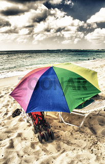 Sandy Beach with colorful Beach Umbrella