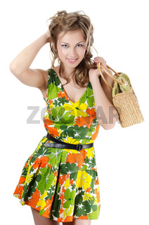 The beautiful girl in a summer dress isolated