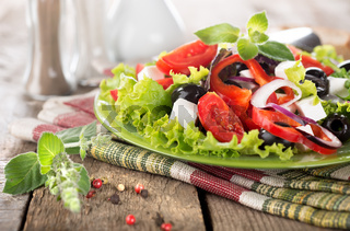 Vegetable salad on a wooden table
