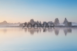 blue sky and fog over lake