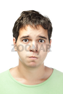 portrait of pitiful young man isolated on white background